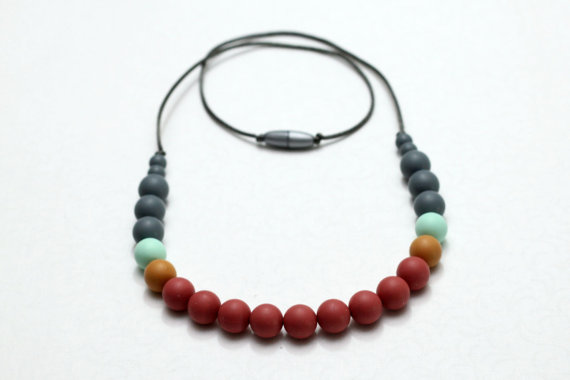 Silicone teething necklace via GettingSewCrafty on etsy.