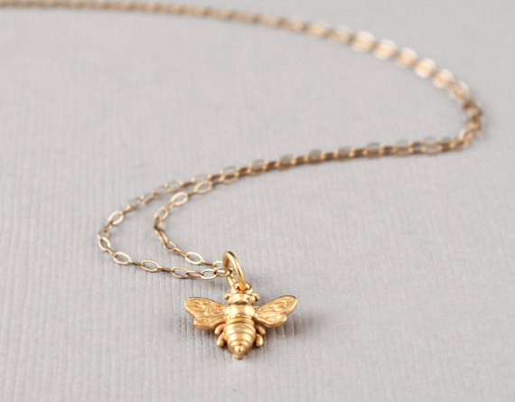 Little gold bee necklace via ACharmedImpression on Etsy