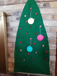 Every day, hang another ornament on the tree until Christmas. The clothespins can then hold Christmas cards as they come in.