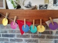 String paper ornaments across your mantel using clothespins